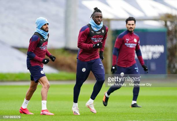 Riyad Mahrez and Benjamin Mendy of Manchester City in action during a training session at Manchester City Football Academy on December 18, 2020 in...