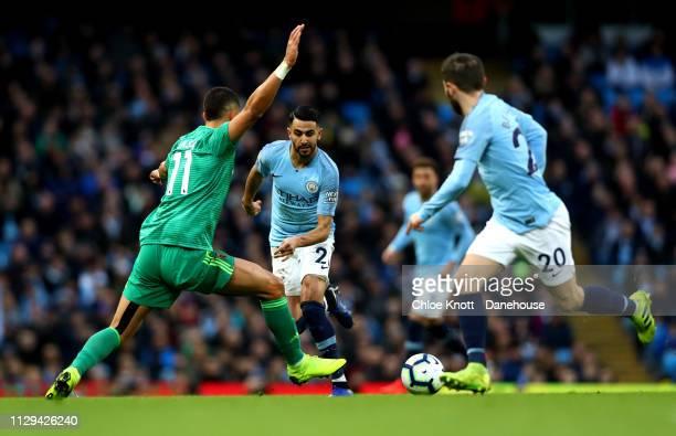 Riyad Mahrez and Bernardo Silva of Manchester City and Adam Masina of Watford FC in action during the Premier League match between Manchester City...