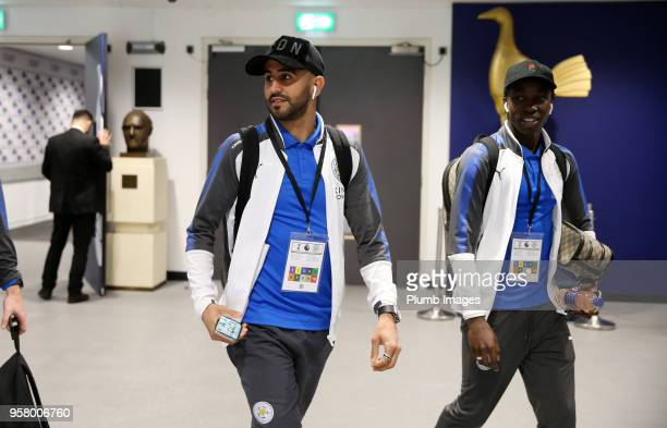 Riyad Mahrez and Fousseni Diabate of Leicester City arrive ahead of the Premier League match between Tottenham Hotspur and Leicester City at Wembley...