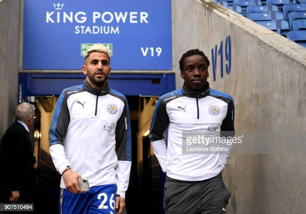 Riyad Mahrez and Fousseni Diabate of Leicester City arrive prior to the Premier League match between Leicester City and Watford at The King Power...