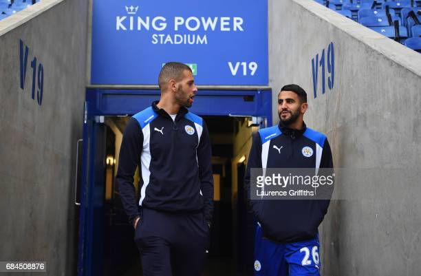 Riyad Mahrez and Islam Slimani of Leicester City in discussion prior to the Premier League match between Leicester City and Tottenham Hotspur at The...