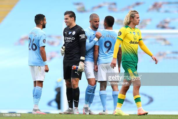 Riyad Mahrez, Ederson, Kyle Walker and Gabriel Jesus all of Manchester City celebrate after the Premier League match between Manchester City and...
