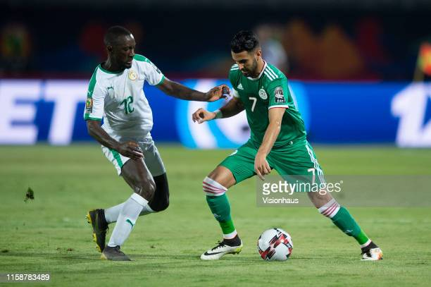 Riyad Mahrez of Algeria and Youssouf Sabaly of Senegal during the 2019 Africa Cup of Nations Group C match between Senegal and Algeria at 30th June...