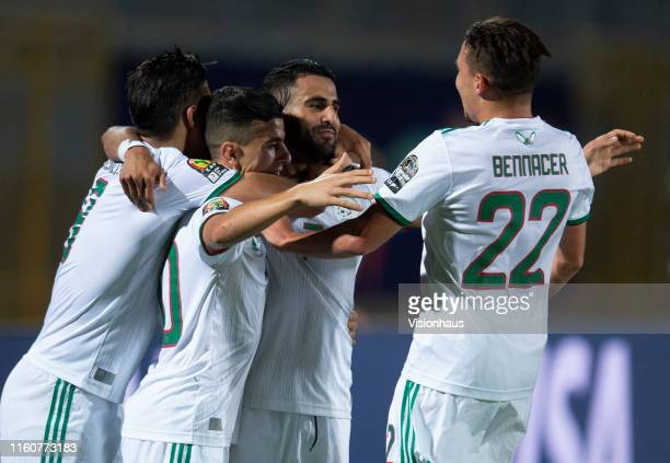 Riyad Mahrez of Algeria celebrates his goal with Youcef Atal Baghdad Bounedjah and Ismael Bennacer during the 2019 Africa Cup of Nations Round of 16...