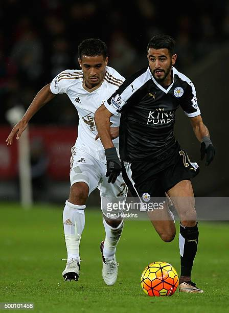 Riyad Mahrez of Leicester advances under pressure from Jefferson Montero of Swansea during the Barclays Premier League match between Swansea City and...