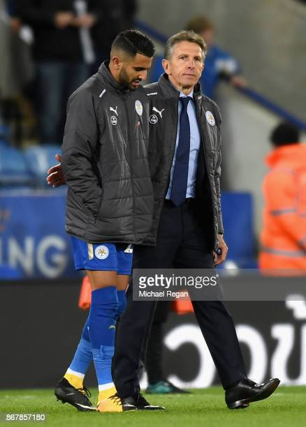 Riyad Mahrez of Leicester City and Claude Puel Manager of Leicester City in discussion after the Premier League match between Leicester City and...