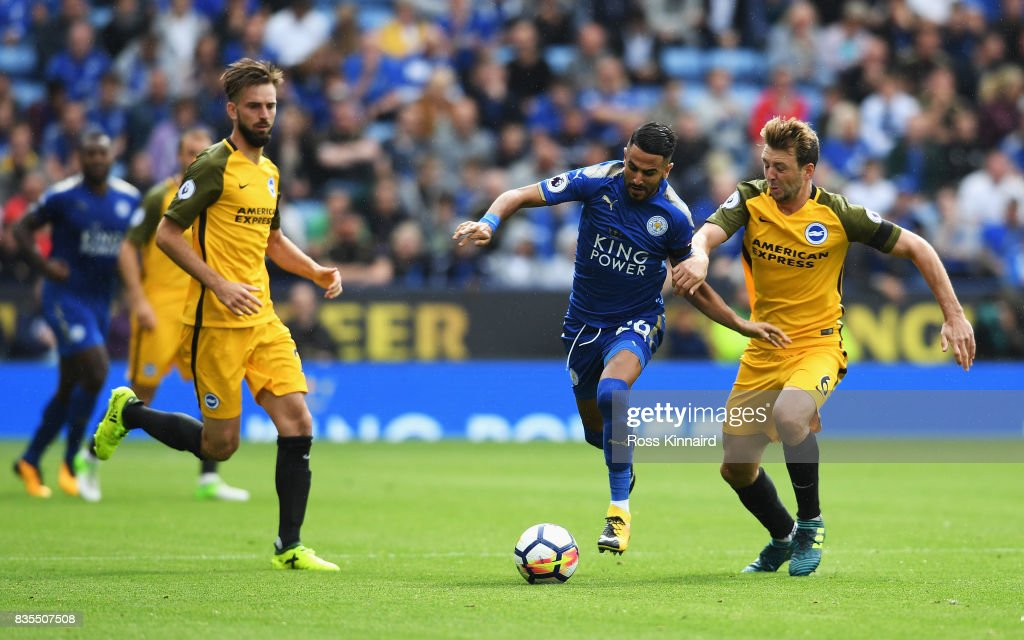 Riyad Mahrez of Leicester City and Dale Stephens of Brighton and Hove Albion battle for possession during the Premier League match between Leicester City and Brighton and Hove Albion at The King Power Stadium on August 19, 2017 in Leicester, England.