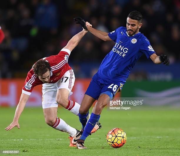 Riyad Mahrez of Leicester City and Daley Blind of Manchester United compete for the ball during the Barclays Premier League match between Leicester...