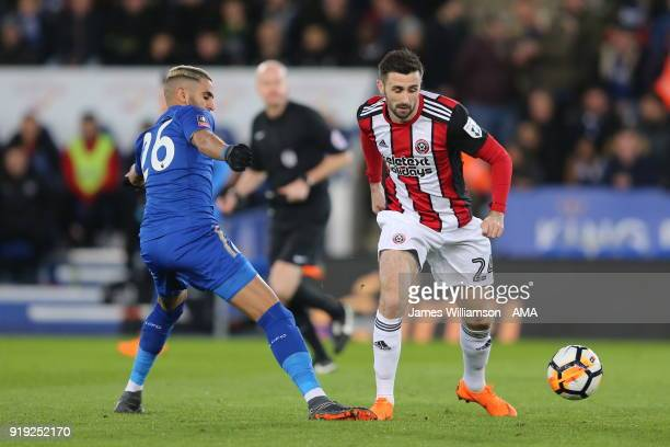 Riyad Mahrez of Leicester City and Danny Lafferty of Sheffield United during the Emirates FA Cup Fifth Round match between Leicester City and...