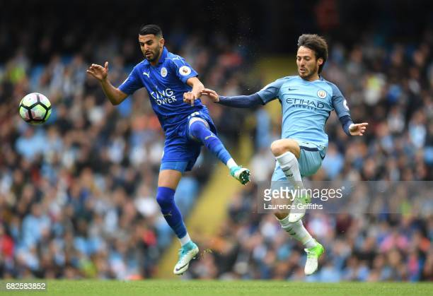 Riyad Mahrez of Leicester City and David Silva of Manchester City battle for possession during the Premier League match between Manchester City and...