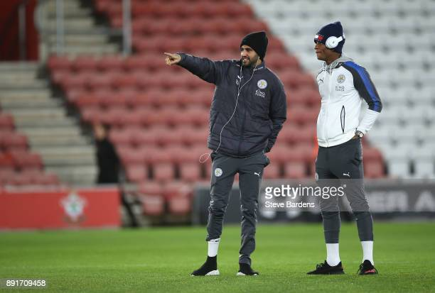 Riyad Mahrez of Leicester City and Demarai Gray of Leicester City speak on the pitch prior to the Premier League match between Southampton and...