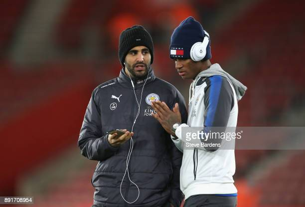 Riyad Mahrez of Leicester City and Demarai Gray of Leicester City listen to music on the pitch prior to the Premier League match between Southampton...