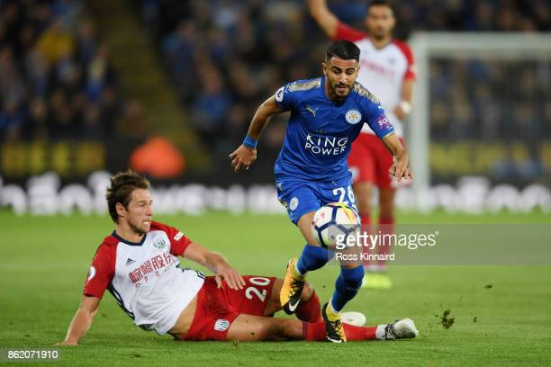 Riyad Mahrez of Leicester City and Grzegorz Krychowiak of West Bromwich Albion in action during the Premier League match between Leicester City and...