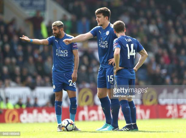 Riyad Mahrez of Leicester City and Harry Maguire of Leicester City react during the Premier League match between Burnley and Leicester City at Turf...