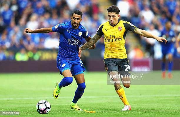 Riyad Mahrez of Leicester City and Hector Bellerin of Arsenal battle for possession during the Premier League match between Leicester City and...
