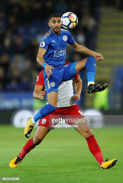 Riyad Mahrez of Leicester City and Jake Livermore of West Bromwich Albion during the Premier League match between Leicester City and West Bromwich...
