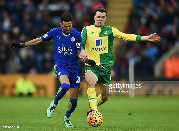 Riyad Mahrez of Leicester City and Jonathan Howson of Norwich City compete for the ball during the Barclays Premier League match between Leicester...