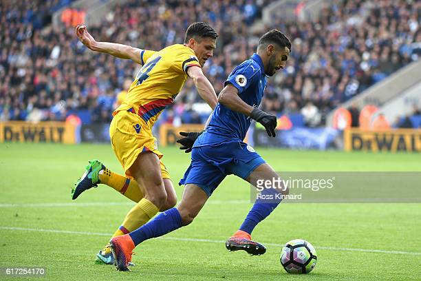 Riyad Mahrez of Leicester City and Martin Kelly of Crystal Palace compete for the ball during the Premier League match between Leicester City and...