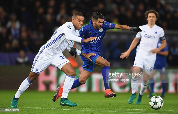 Riyad Mahrez of Leicester City and Mathias Zanka Jorgensen of FC Copenhagen compete for the ball during the UEFA Champions League Group G match...