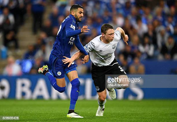 Riyad Mahrez of Leicester City and Matthew Pennington of Everton compete for the ball during the Barclays Premier League match between Leicester City...