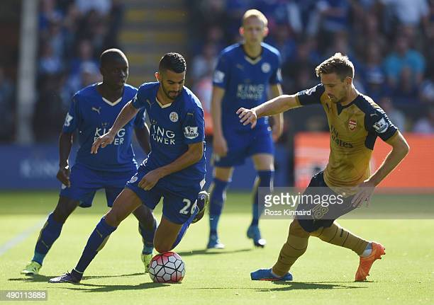 Riyad Mahrez of Leicester City and Nacho Monreal of Arsenal compete for the ball during the Barclays Premier League match between Leicester City and...