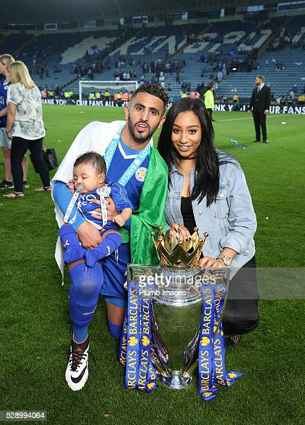Riyad Mahrez of Leicester City and partner Rita Johal celebrate with the Premier League trophy after the Barclays Premier League match between...