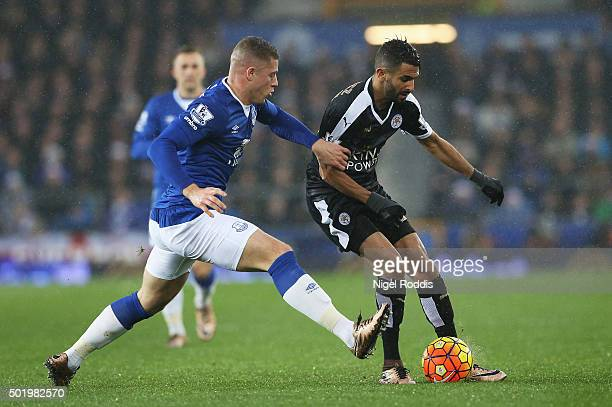 Riyad Mahrez of Leicester City and Ross Barkley of Everton compete for the ball during the Barclays Premier League match between Everton and...