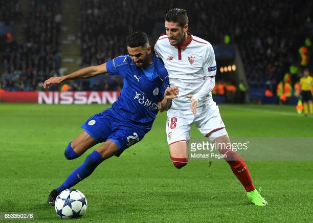 Riyad Mahrez of Leicester City and Sergio Escudero of Sevilla battle for the ball during the UEFA Champions League Round of 16 second leg match...