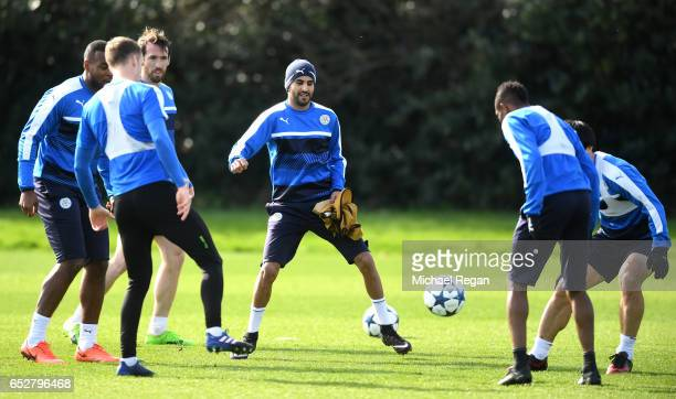 Riyad Mahrez of Leicester City and team mates practice training drills during a Leicester City Training Session ahead of their UEFA Champions League...