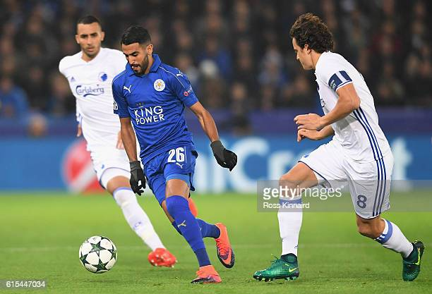 Riyad Mahrez of Leicester City and Thomas Delaney of FC Copenhagen compete for the ball during the UEFA Champions League Group G match between...