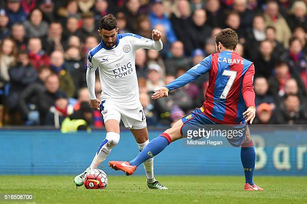 Riyad Mahrez of Leicester City and Yohan Cabaye of Crystal Palace compete for the ball during the Barclays Premier League match between Crystal...