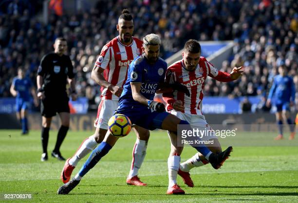 Riyad Mahrez of Leicester City battles for possesion with Konstantinos Stafylidis of Stoke City during the Premier League match between Leicester...