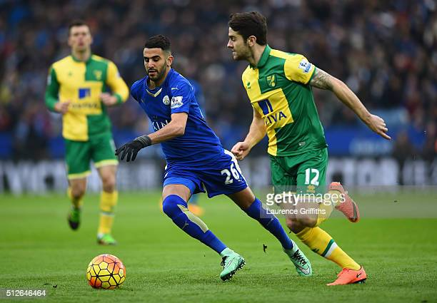 Riyad Mahrez of Leicester City battles with Robbie Brady of Norwich City during the Barclays Premier League match between Leicester City and Norwich...