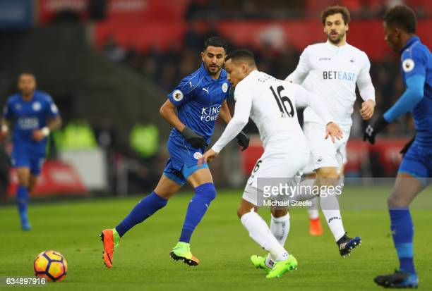 Riyad Mahrez of Leicester City beats Martin Olsson of Swansea City to the ball during the Premier League match between Swansea City and Leicester...