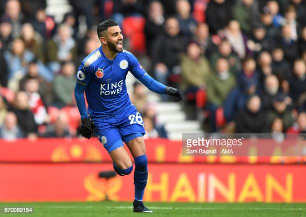 Riyad Mahrez of Leicester City celebrates after scoring a goal to make it 12 during the Premier League match between Stoke City and Leicester City at...