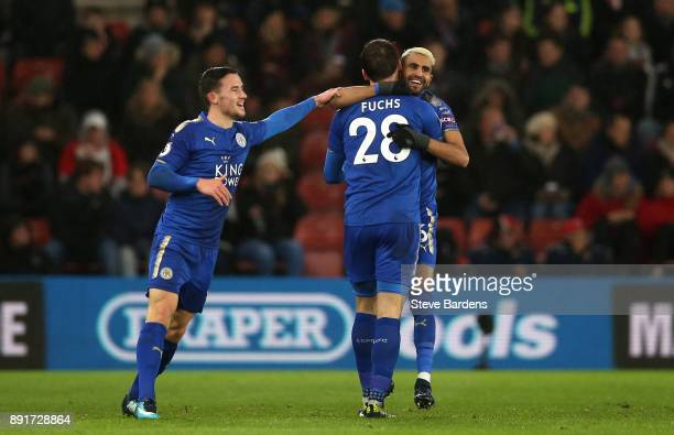 Riyad Mahrez of Leicester City celebrates after scoring his sides first goal with Christian Fuchs of Leicester City and Ben Chilwell of Leicester...