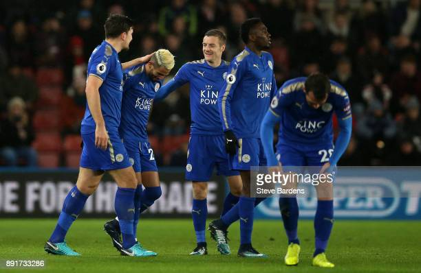 Riyad Mahrez of Leicester City celebrates after scoring his sides first goal with his Leicester City team mates during the Premier League match...
