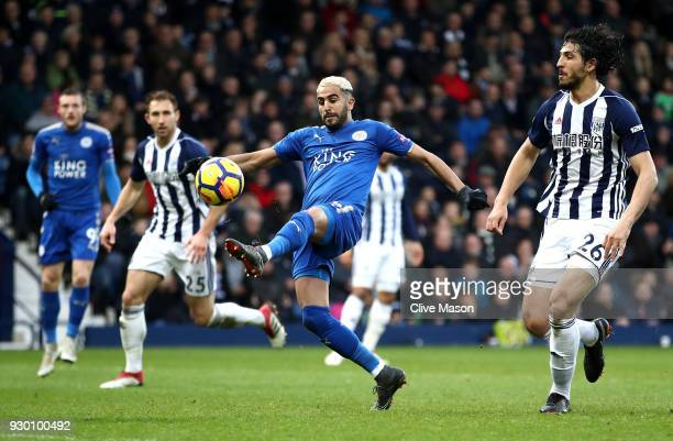 Riyad Mahrez of Leicester City celebrates after scoring his sides second goal past Ben Foster of West Bromwich Albion during the Premier League match...