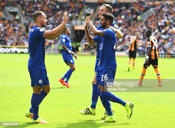 Riyad Mahrez of Leicester City celebrates scoring his sides first goal with his team mate Daniel Drinkwater of Leicester City during the Premier...
