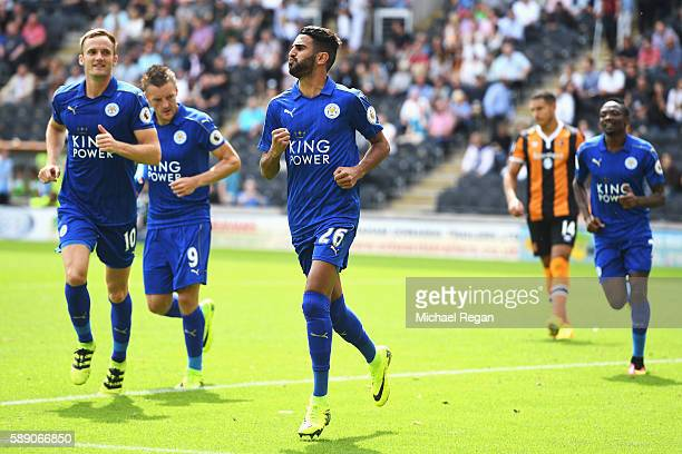Riyad Mahrez of Leicester City celebrates scoring his sides first goal with his team mates during the Premier League match between Hull City and...