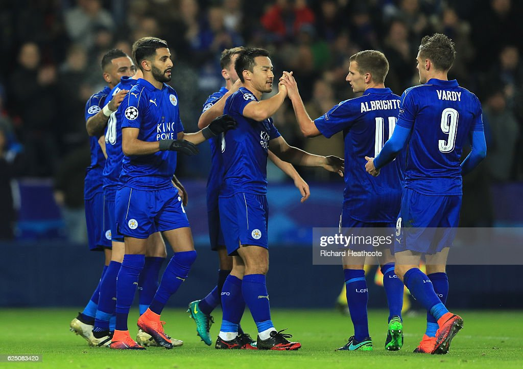 Riyad Mahrez of Leicester City celebrates scoring his sides second goal with team mates during the UEFA Champions League match between Leicester City FC and Club Brugge KV at The King Power Stadium on November 22, 2016 in Leicester, England.