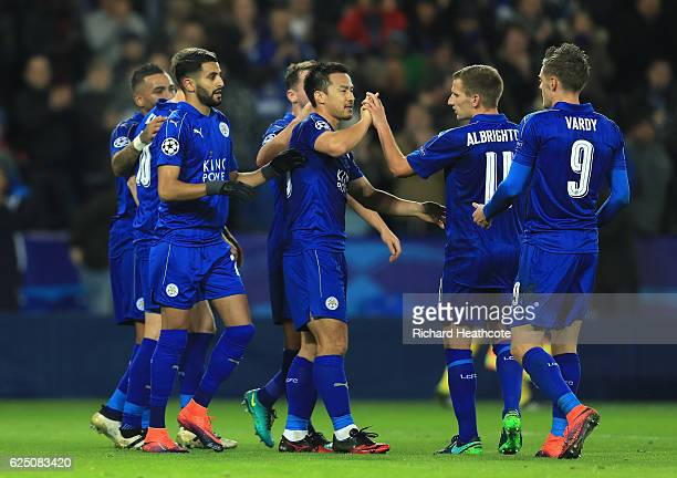 Riyad Mahrez of Leicester City celebrates scoring his sides second goal with team mates during the UEFA Champions League match between Leicester City...