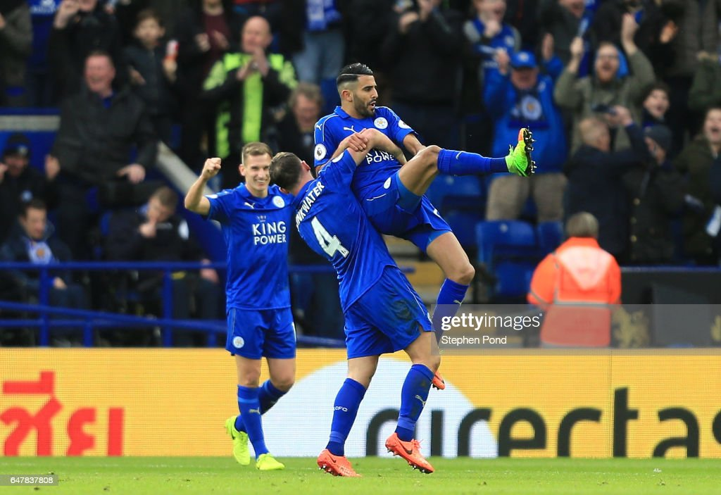 Riyad Mahrez of Leicester City (R) celebrates scoring his sides second goal with Danny Drinkwater of Leicester City (L) during the Premier League match between Leicester City and Hull City at The King Power Stadium on March 4, 2017 in Leicester, England.