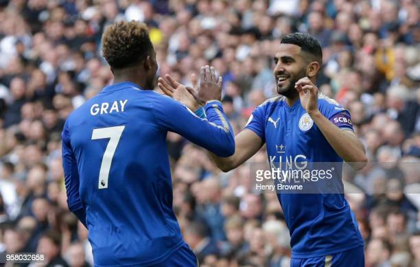 Riyad Mahrez of Leicester City celebrates scoring his sides second goal with team mate Demarai Gray of Leicester City during the Premier League match...