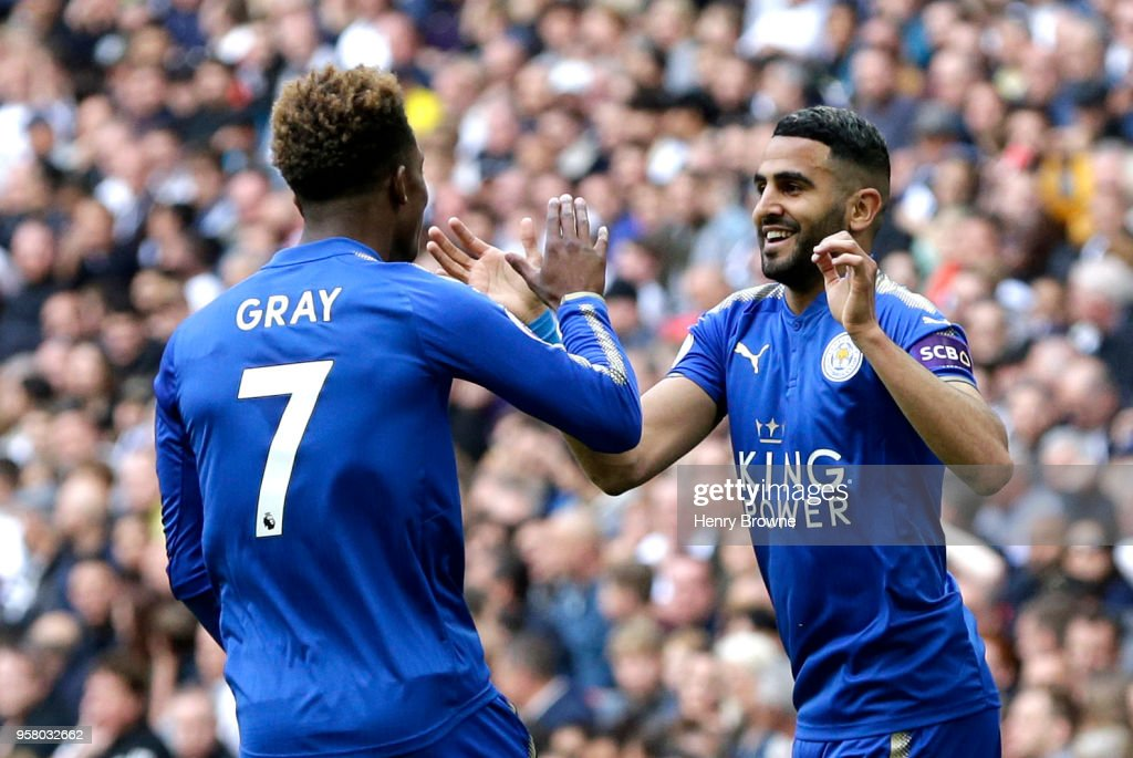 Riyad Mahrez of Leicester City celebrates scoring his sides second goal with team mate Demarai Gray of Leicester City during the Premier League match between Tottenham Hotspur and Leicester City at Wembley Stadium on May 13, 2018 in London, England.