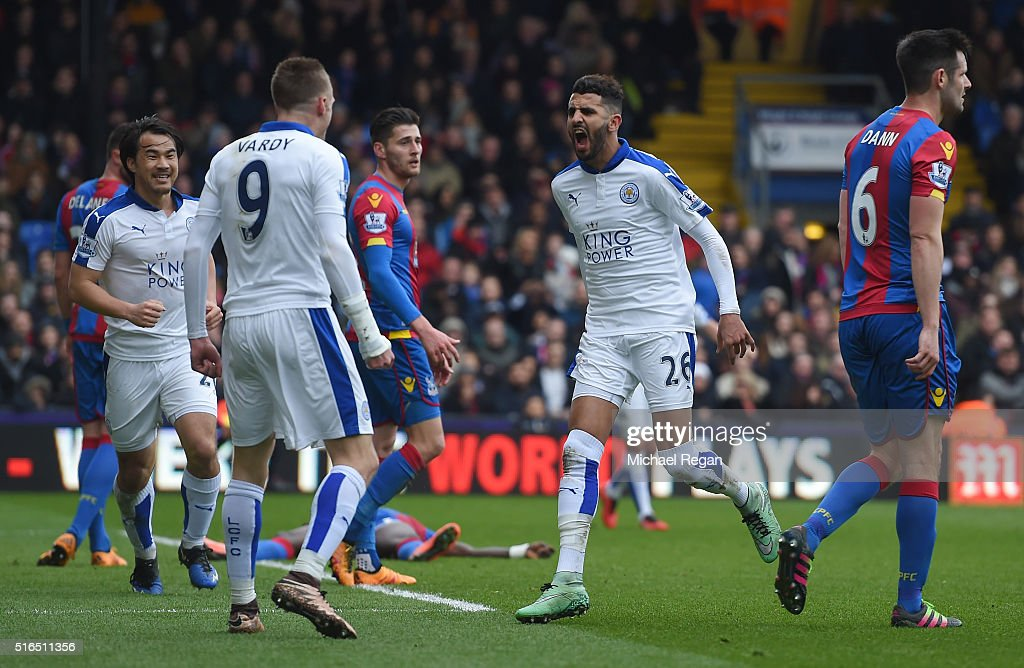 Riyad Mahrez (R) of Leicester City celebrates scoring his team's first goal with his team mate Jamie Vardy (L) during the Barclays Premier League match between Crystal Palace and Leicester City at Selhurst Park on March 19, 2016 in London, United Kingdom.