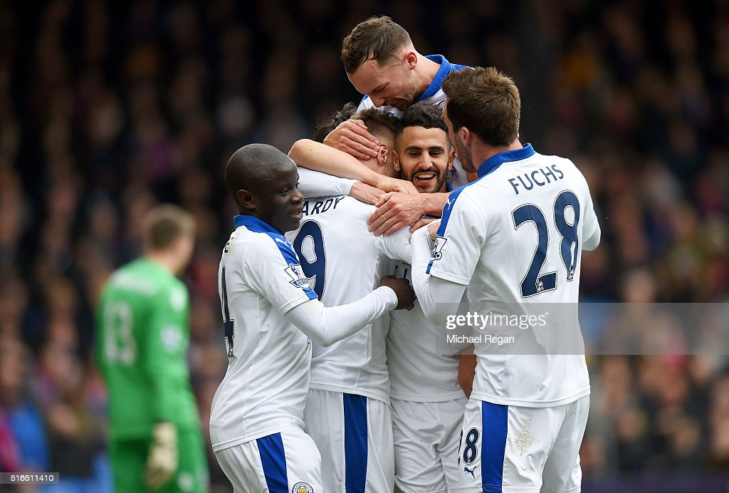 Riyad Mahrez (2nd R) of Leicester City celebrates scoring his team's first goal with his team mates during the Barclays Premier League match between Crystal Palace and Leicester City at Selhurst Park on March 19, 2016 in London, United Kingdom.