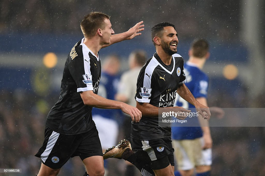 Riyad Mahrez (R) of Leicester City celebrates scoring his team's second goal with his team mate Marc Albrighton (L) during the Barclays Premier League match between Everton and Leicester City at Goodison Park on December 19, 2015 in Liverpool, England.