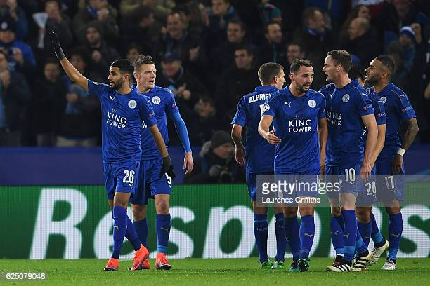 Riyad Mahrez of Leicester City celebrates scoring his teams second goal with teammates during the UEFA Champions League Group G match between...