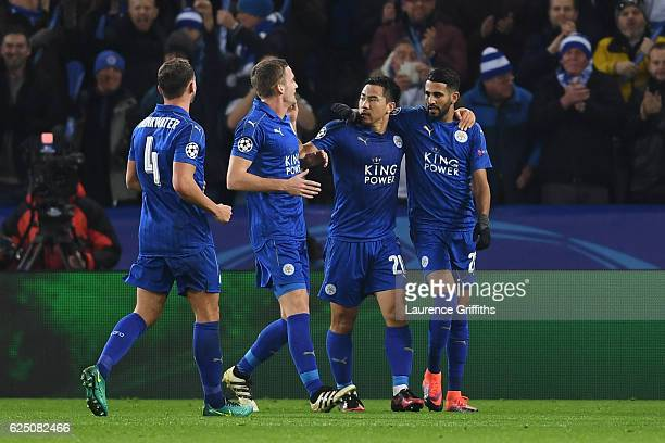 Riyad Mahrez of Leicester City celebrates scoring his teams second with teammates during the UEFA Champions League Group G match between Leicester...